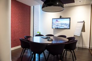 Conference room with video conferencing set up; image by Arlington Research, via Unsplash.com.