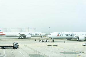 Two American Airlines planes at London Heathrow Airport; image by Damian Hutter, via Unsplash.com.