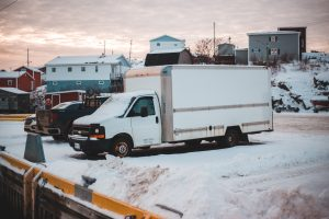 White box truck in a parking lot; image by Erik Mclean, via Unsplash.com.