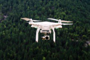 White drone, mid-flight; image by Jason Blackeye.