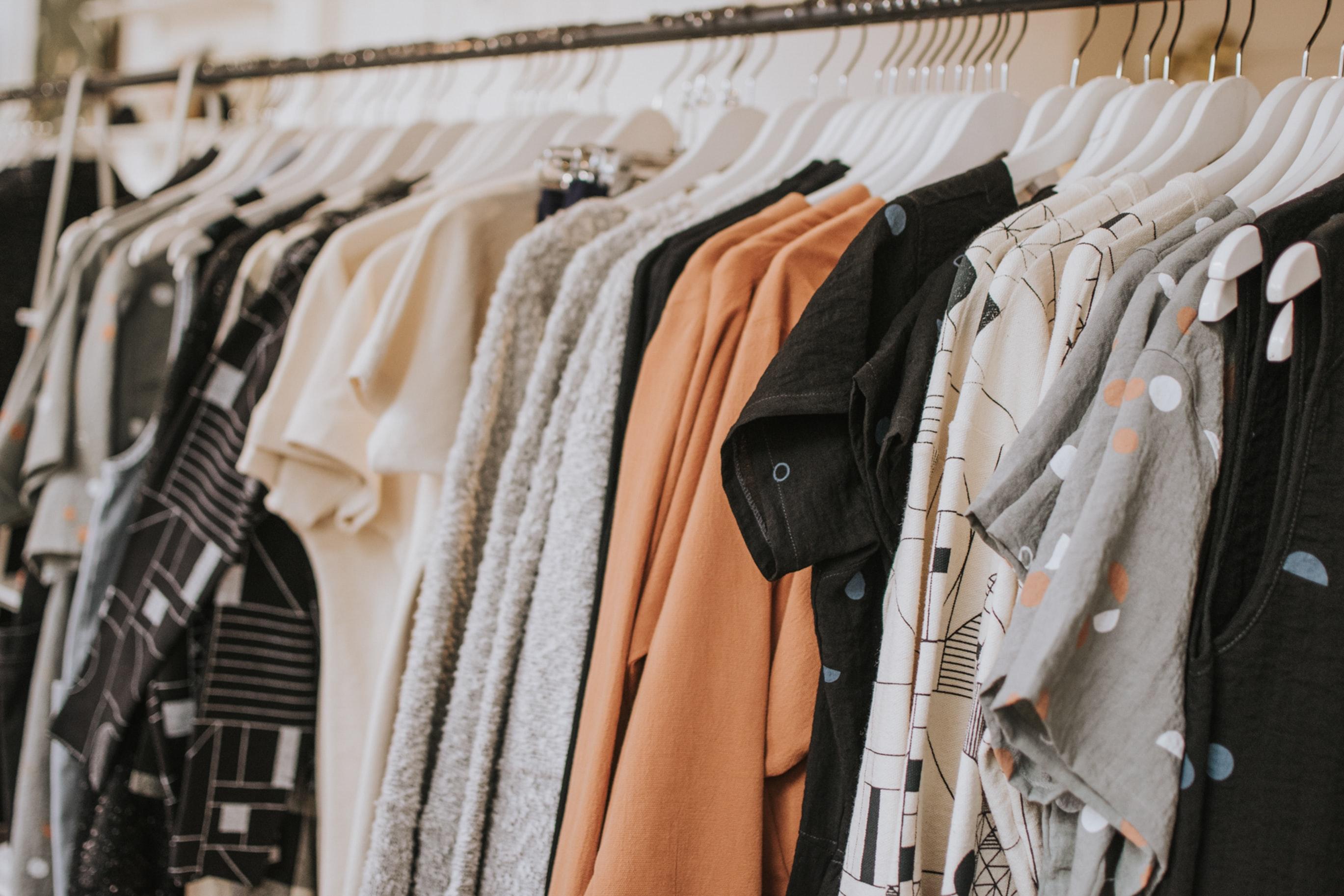 Clothing rack full of tops; image by Lauren Fleischmann, via Unsplash.com.