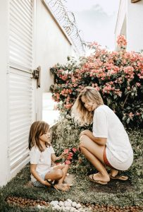 Mother and daughter in garden; image by Jonathan Borba, via Pexels.com.