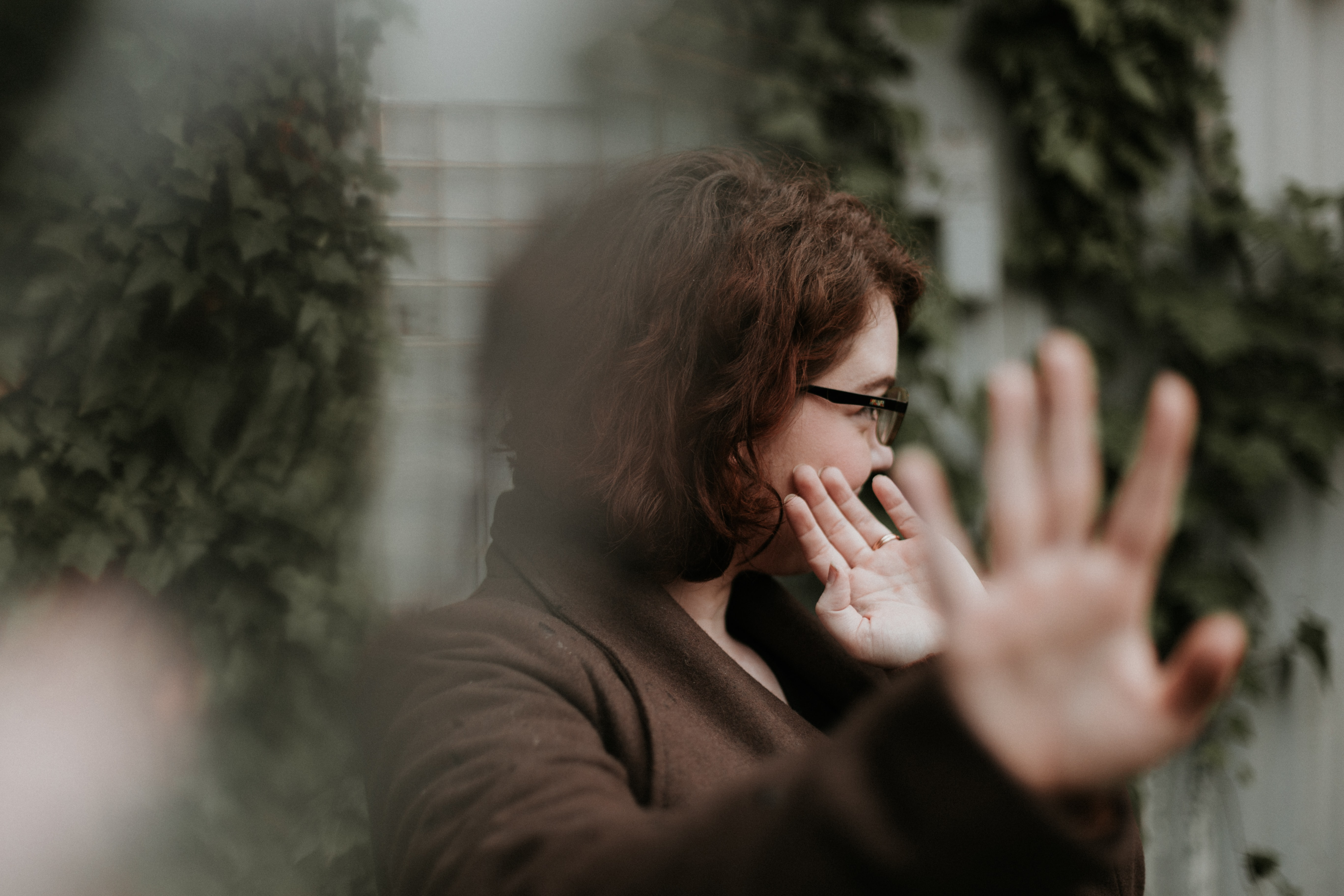 Woman in brown jacket turning away from camera; image by Priscilla Du Preez, via Unsplash.com.