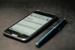 Smartphone with stylus; image be Steve Johnson, via Unsplash.com.