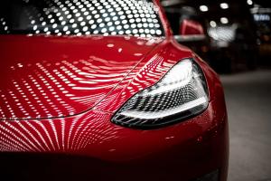 Tesla Model 3 Headlights in Dever; image by Vlad Tchompalov, via Unsplash.com.