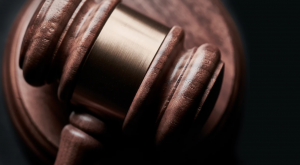 Close-up of gavel; image by Bill Oxford, via Unsplash.com.