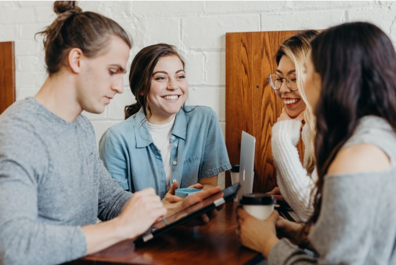 Group sitting at table with laptop and tablet and coffee; image by Brooke Cagle, via Unsplash.com.