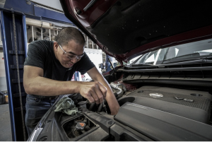 Mechanic working on car; image by DokaRyan, via Pixabay.com.