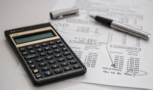 Calculator, pen, and budget worksheet; image by Pixabay, via Pexels.com.
