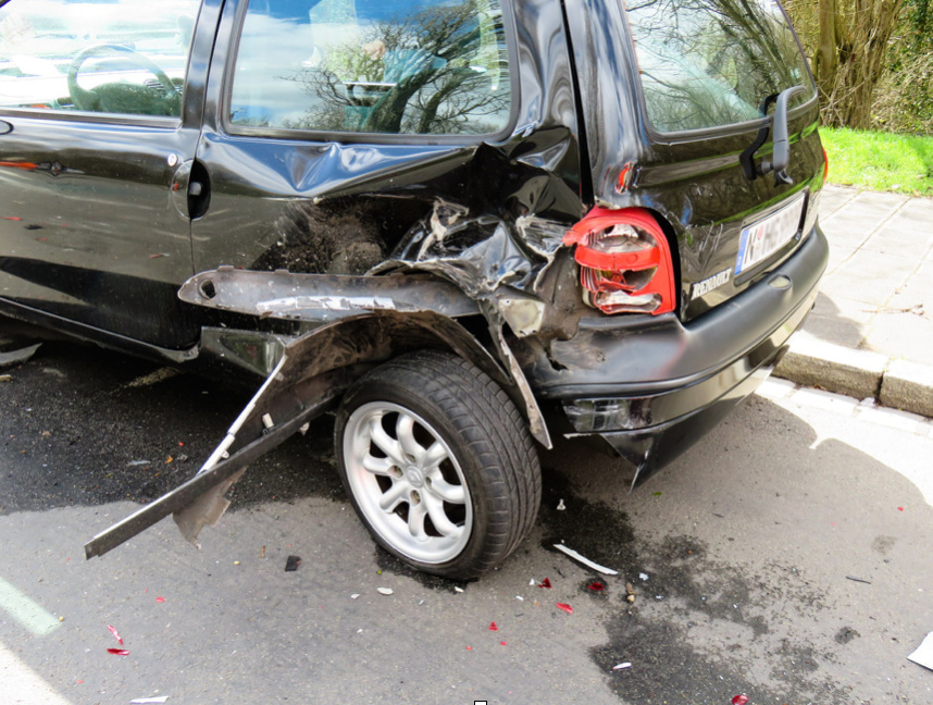 Black van with left rear damage after accident; image by Gellinger, via Pixabay.com.