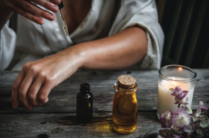 Person applying oil to skin of arm; image by Chelsea Shapouri, via Unsplash.com.