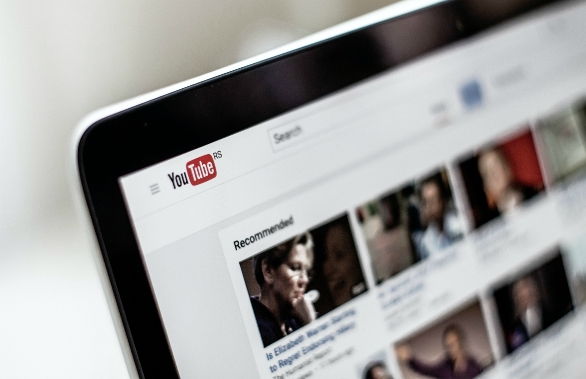 Up-close photo of YouTube on a smartphone; image by NordWood Themes, via Unsplash.con.