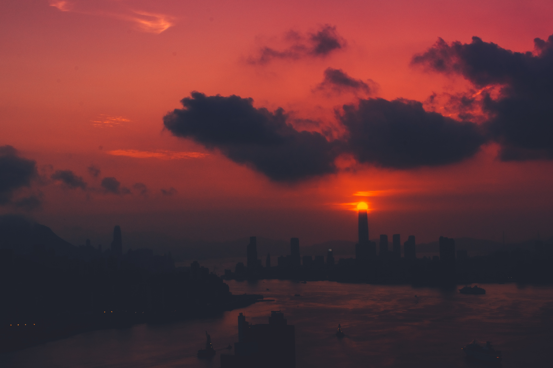 Hong Kong at sunset (the sun performing the part of the Eye of Sauron); image by Joel Fulgencio, via Unsplash.com.