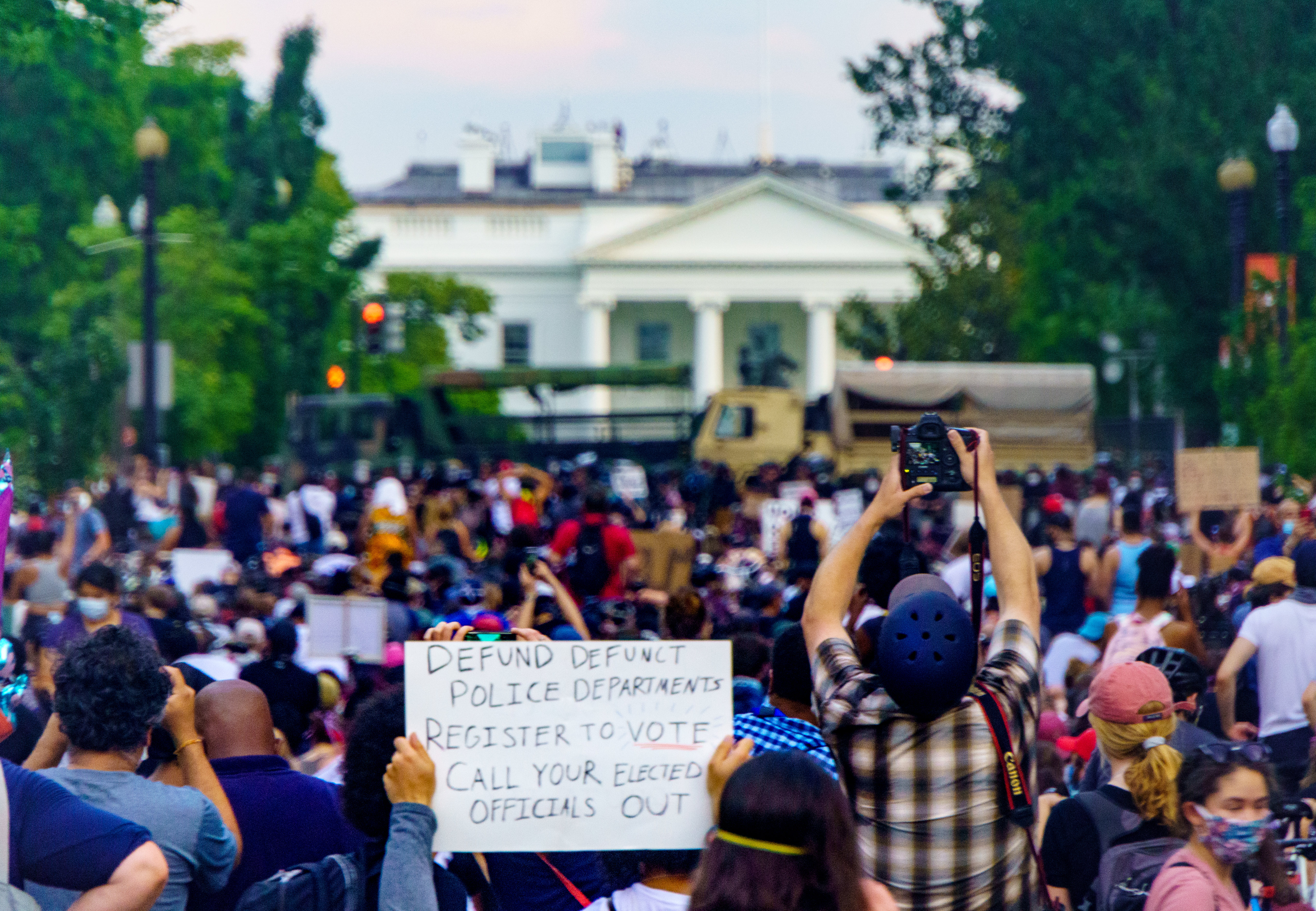 Peaceful protesters crowd in front of the White House.