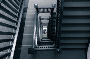 Person at bottom of stairs; image by Free-Photos, via Pixabay.com.