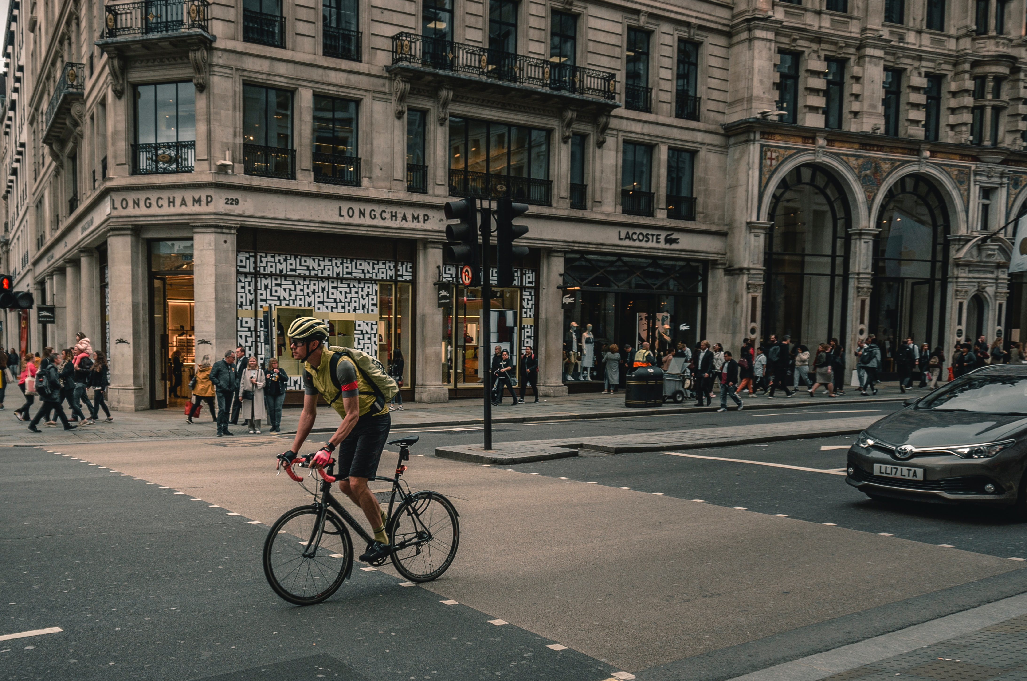 Cyclist and motorist on the road; image by Karl Bewick, via Unsplash.com.