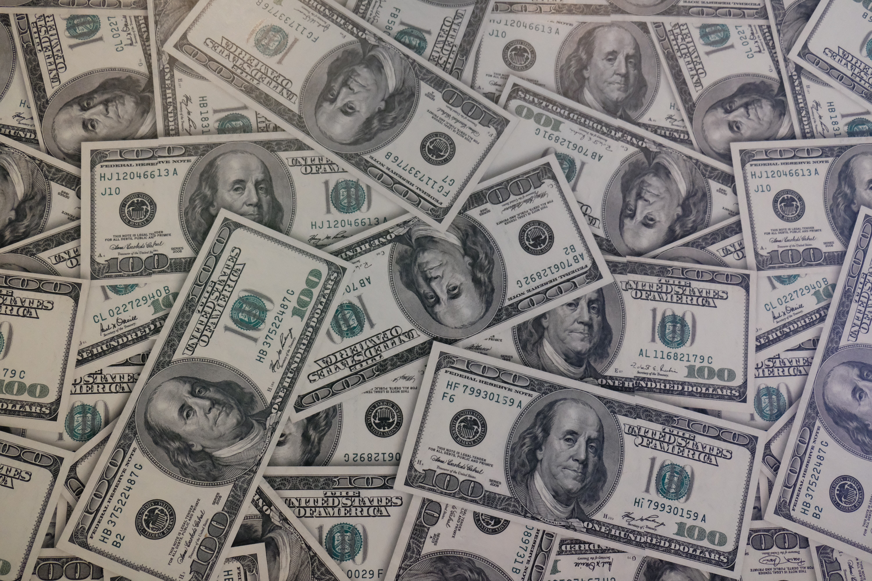 Hundred dollar bills; image by Mackenzie Marco, via Unsplash.com.