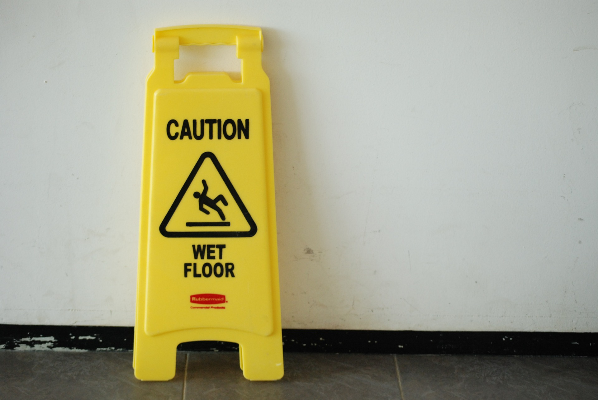 "Yellow ""Caution Wet Floor"" sign; image by adpeople0, via Pixabay.com."