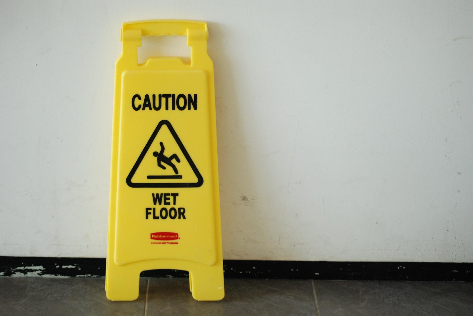 "Yellow ""Caution Wet Floor"" sign; image by adpeople0, via Pixabay.com."