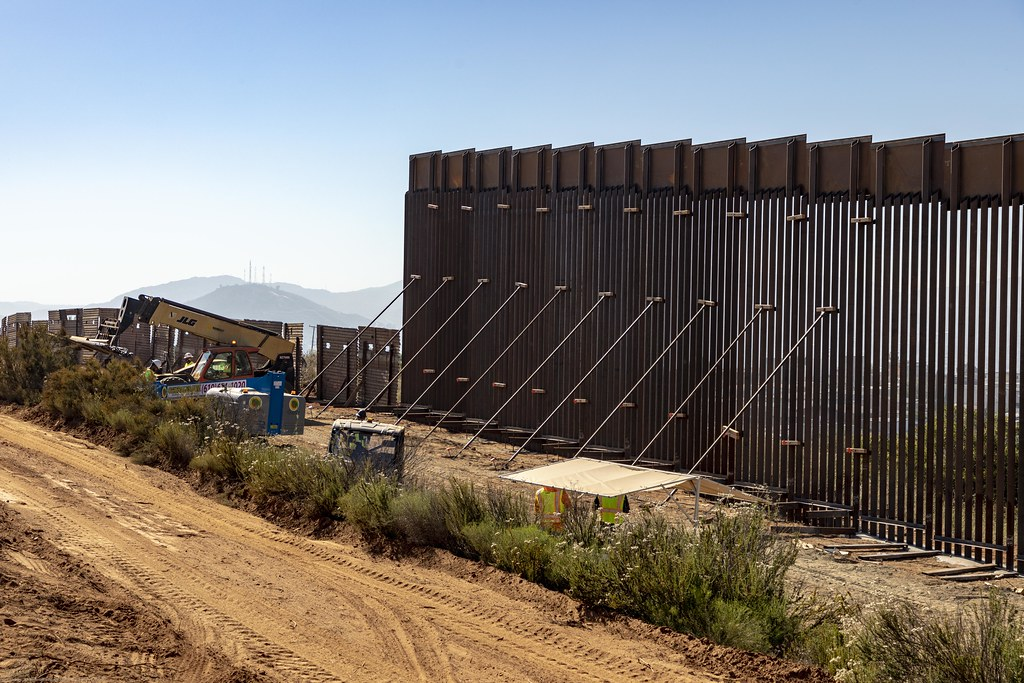 A construction crew working on the border wall.
