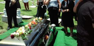 Casket surrounded by mourners