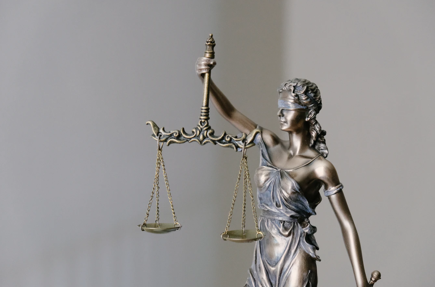 Lady Justice; image by Tingey Injury Law Firm, via Unsplash.com.