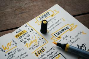 Yellow highlighter on journal; image by Estée Janssens, via Unsplash.com.