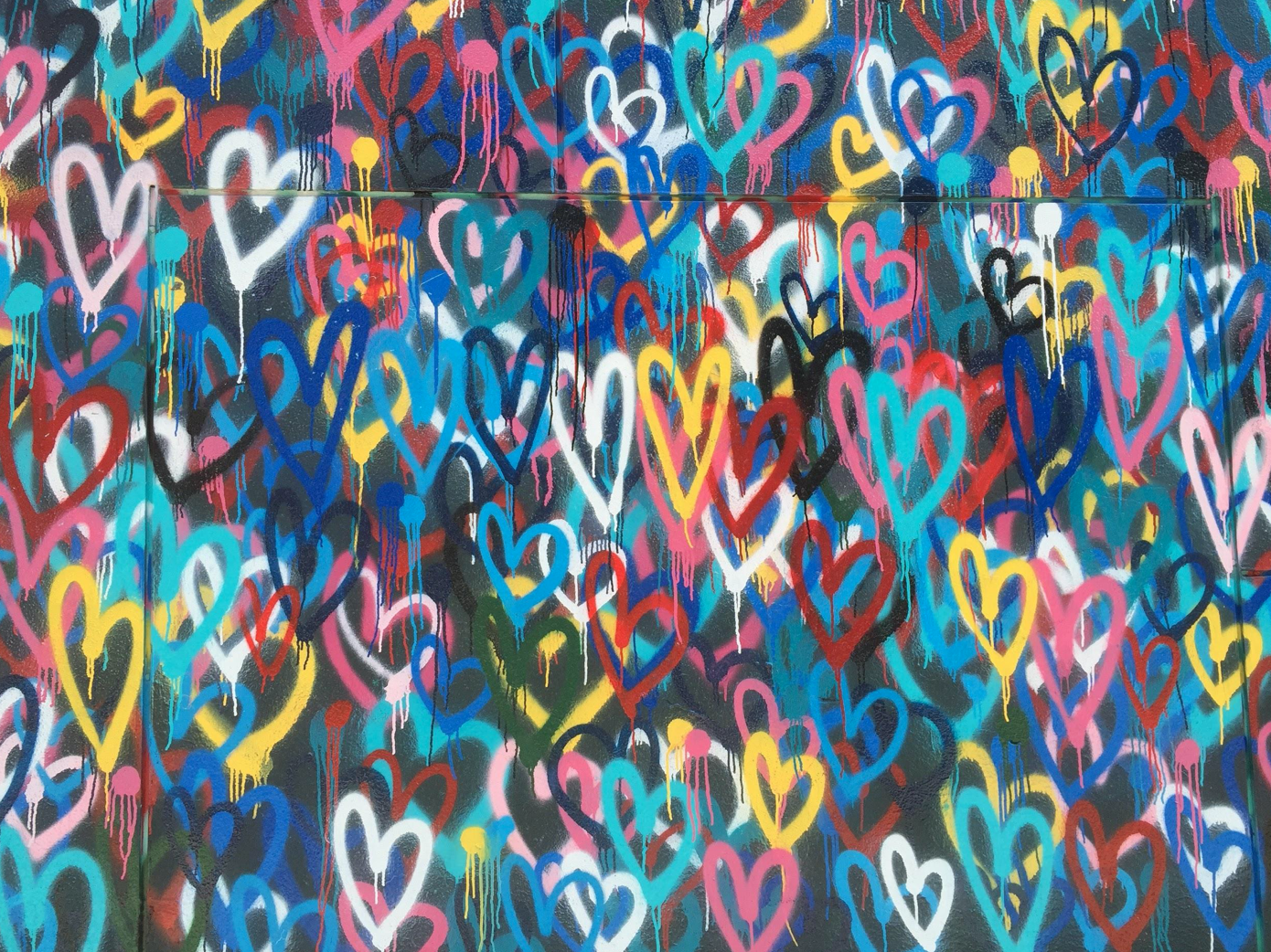 Multi-colored heart wallpaper; image by Renee Fisher, via Unsplash.com.