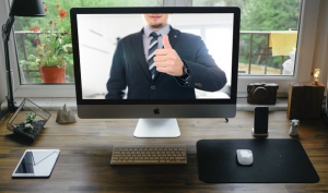 Online meeting, man in suit giving thumbs up gesture; image by Tumisu, via Pixabay.com.