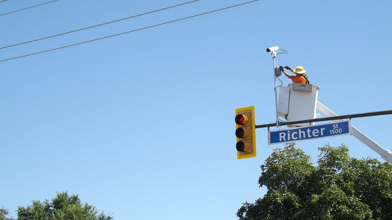 Worker installing a traffic camera