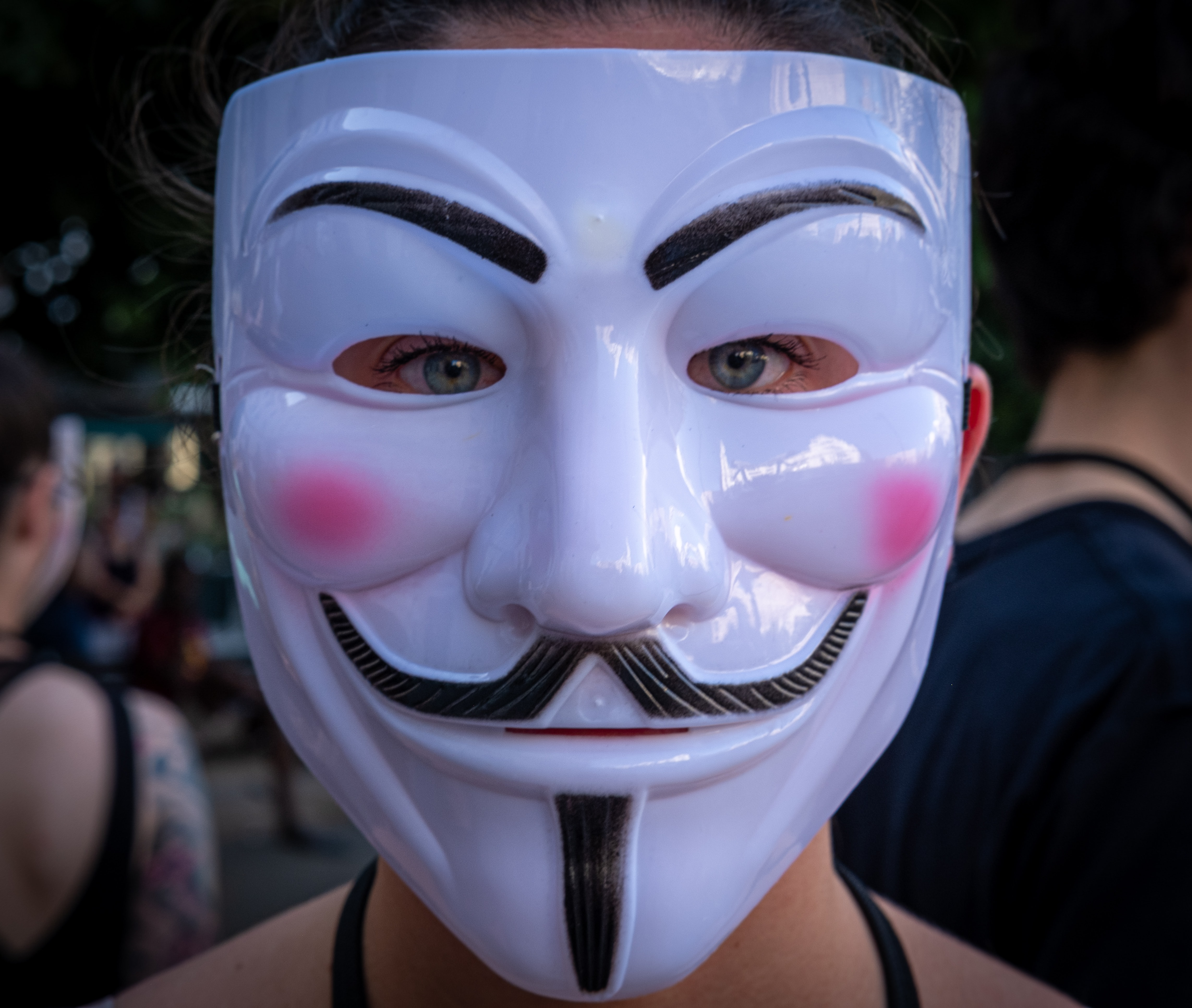 Person wearing Guy Fawkes mask; image by Guillermo Latorre, via Unsplash.com.