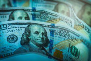 Close-up of $100 bills; image by Jeshoots, via Pixabay.com.