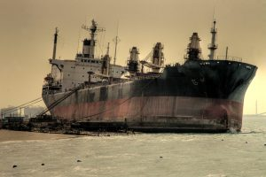 Large abandoned ship under an overcast sky.