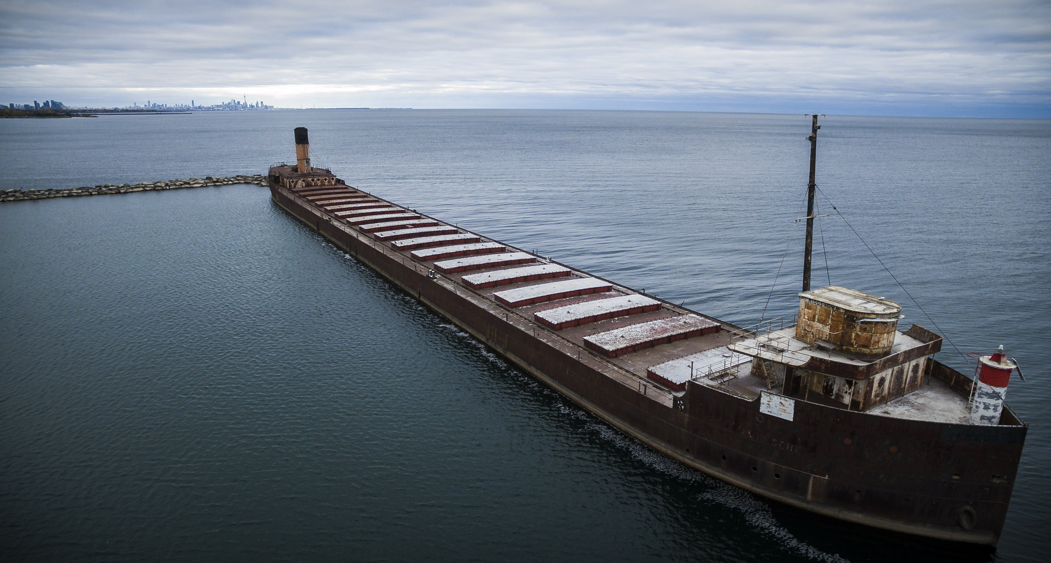 Abandoned tanker ship in a cloudy port.