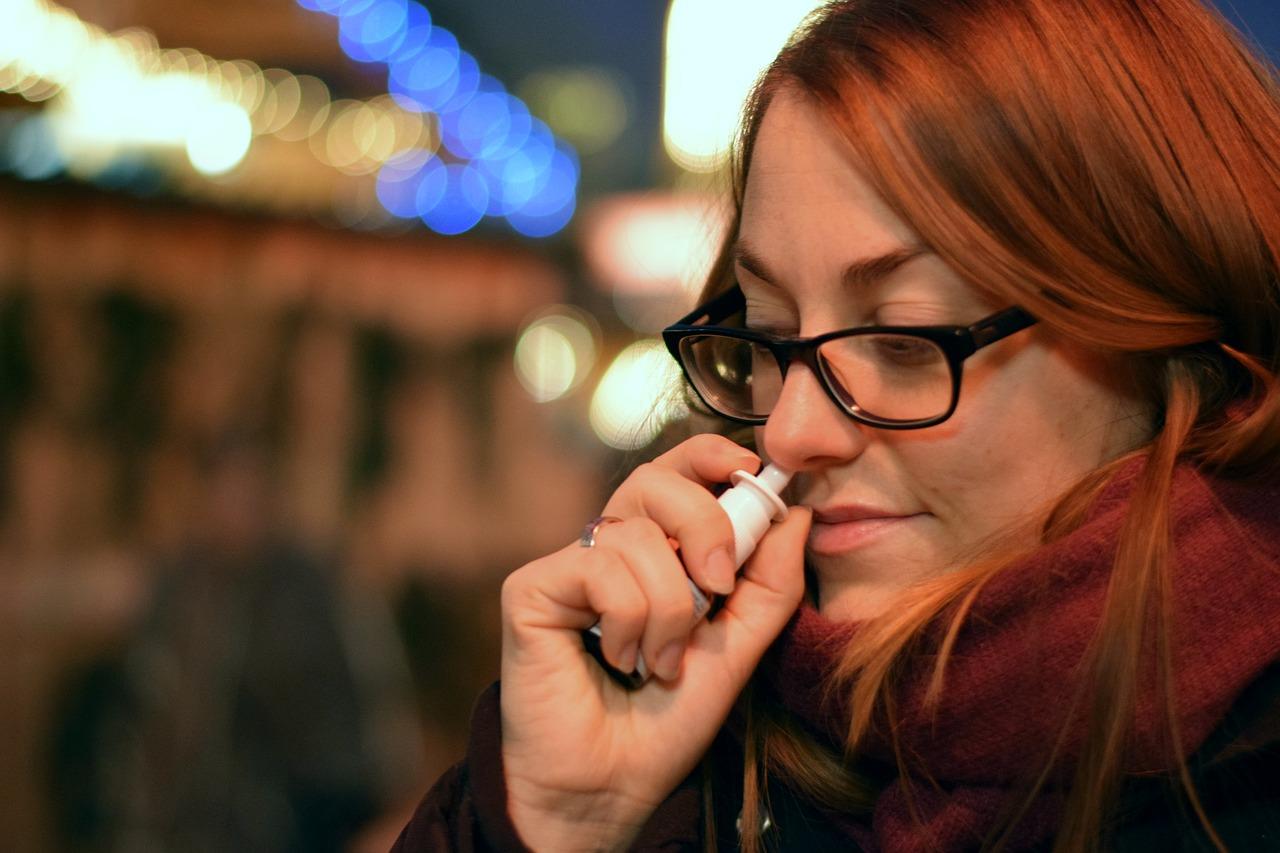 Adult woman using nasal spray