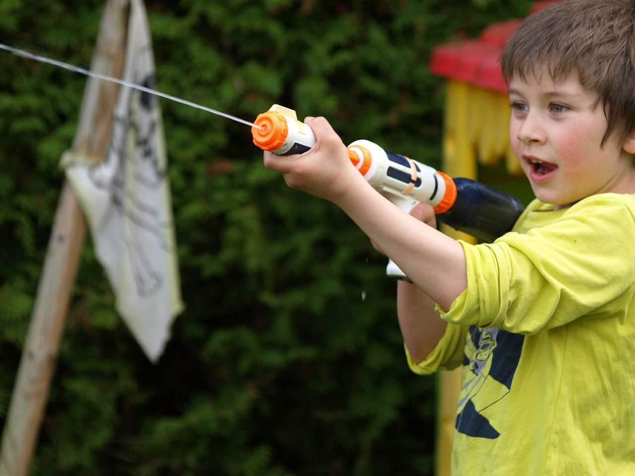 Child with a water gun