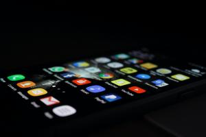 Smartphone with apps showing on screen; image by Rami Al-zayat, via Unsplash.com.