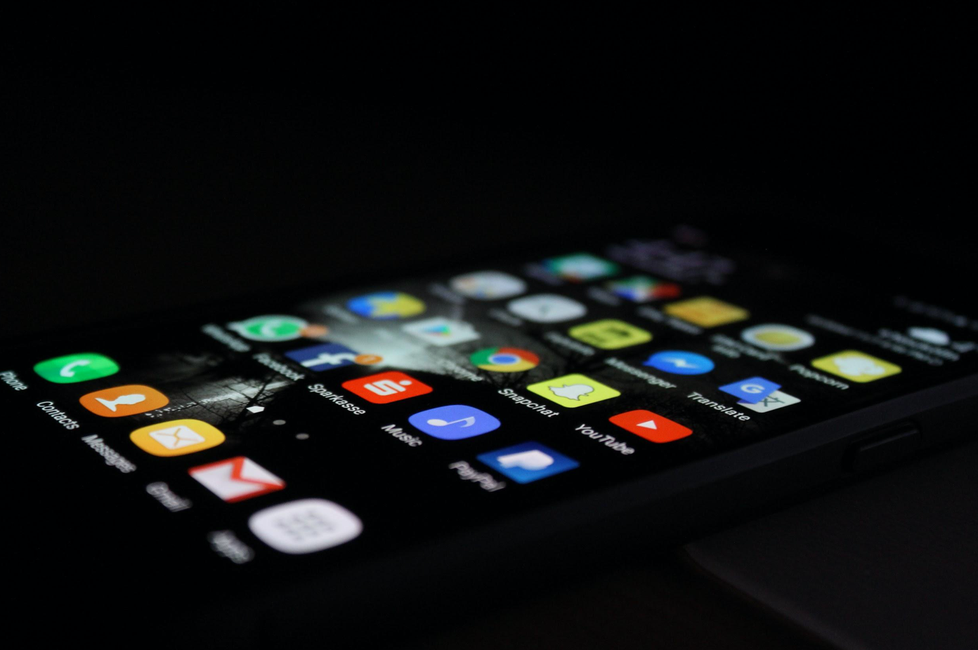 Smartphone with apps showing on screen; image by Rami Al-zayat, via Unsplash.com.