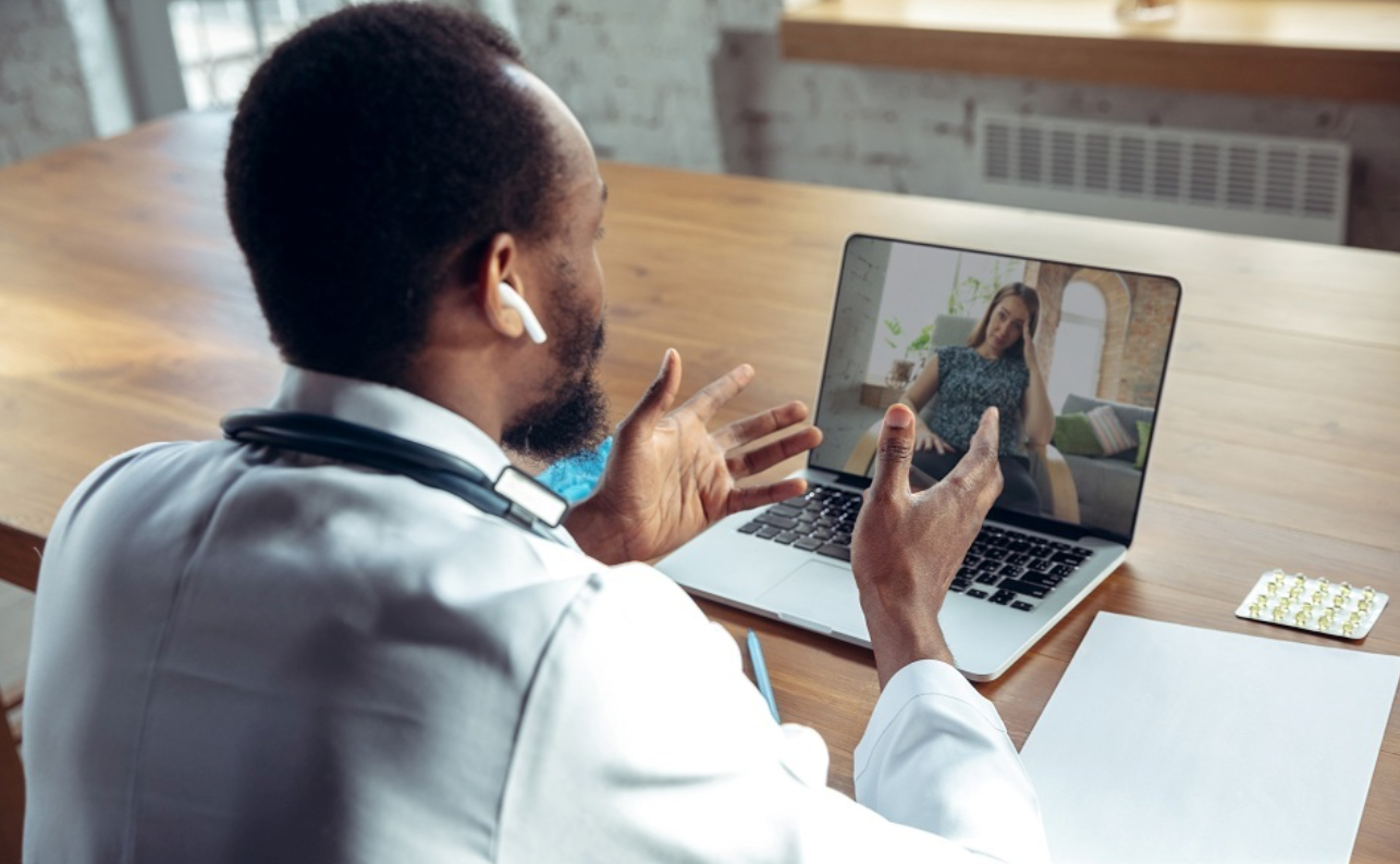 Doctor advising patient via laptop telemedicine; image by Master1305, via Freepik.com.