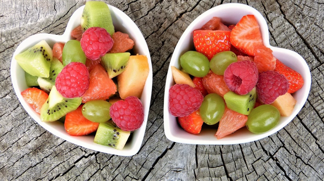 Fruit salad in white, heart-shaped bowls; image by Silviarita, via Pixabay.com.