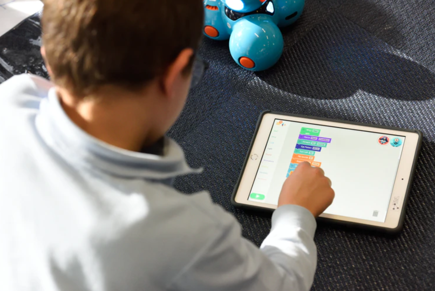 Young male student using tablet; image by stem.T4L, via Unsplash.com.