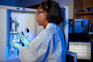 This 2007 photograph depicts CDC Guest Researcher, Dr. Karidia Diallo, preparing the ABI DNA Analyzer. Image by CDC/Hsi Liu, Ph.D., MBA; James Gathany, Public Domain.