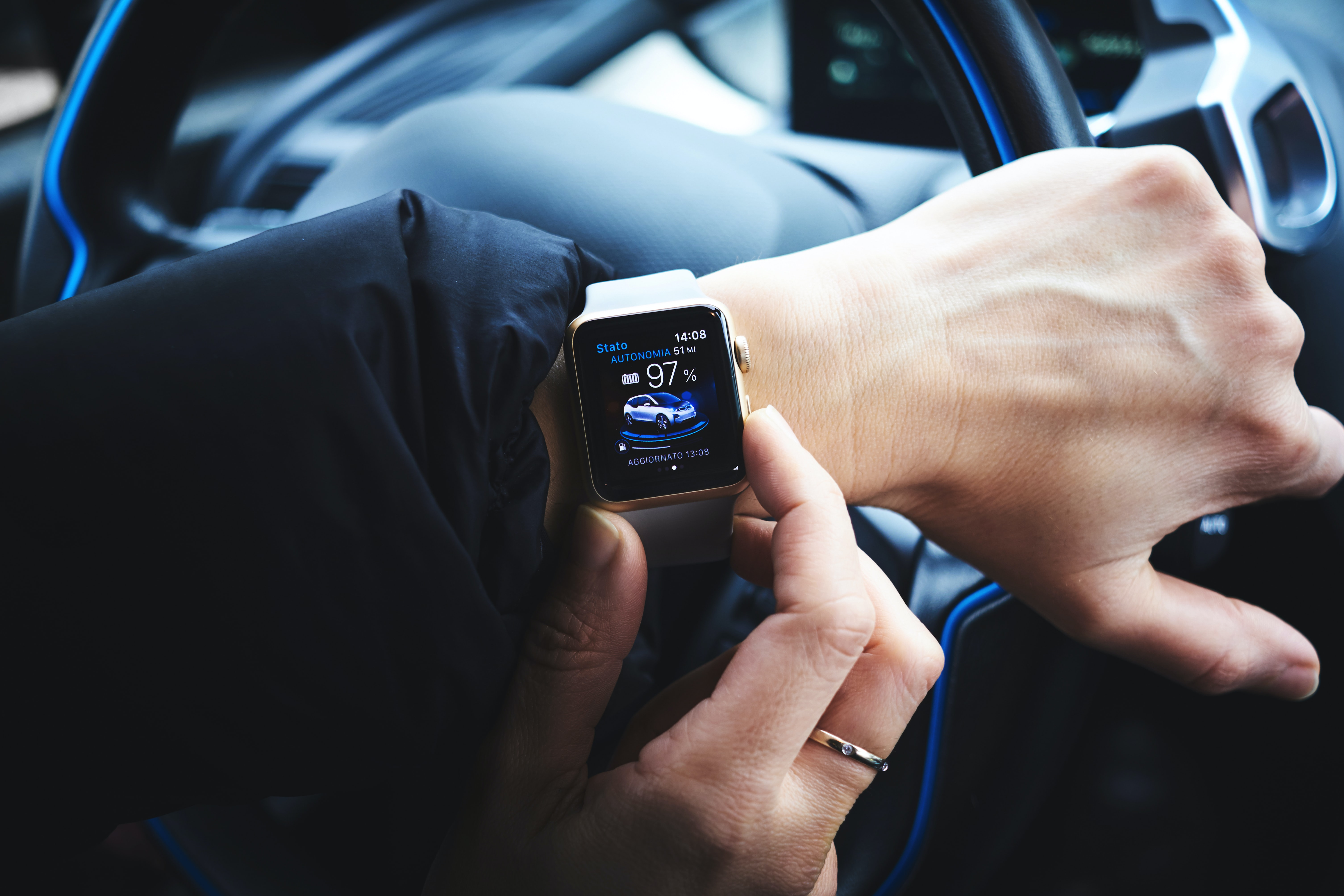 Driver with an Apple Watch; image by Luca Bravo, via Unsplash.com.