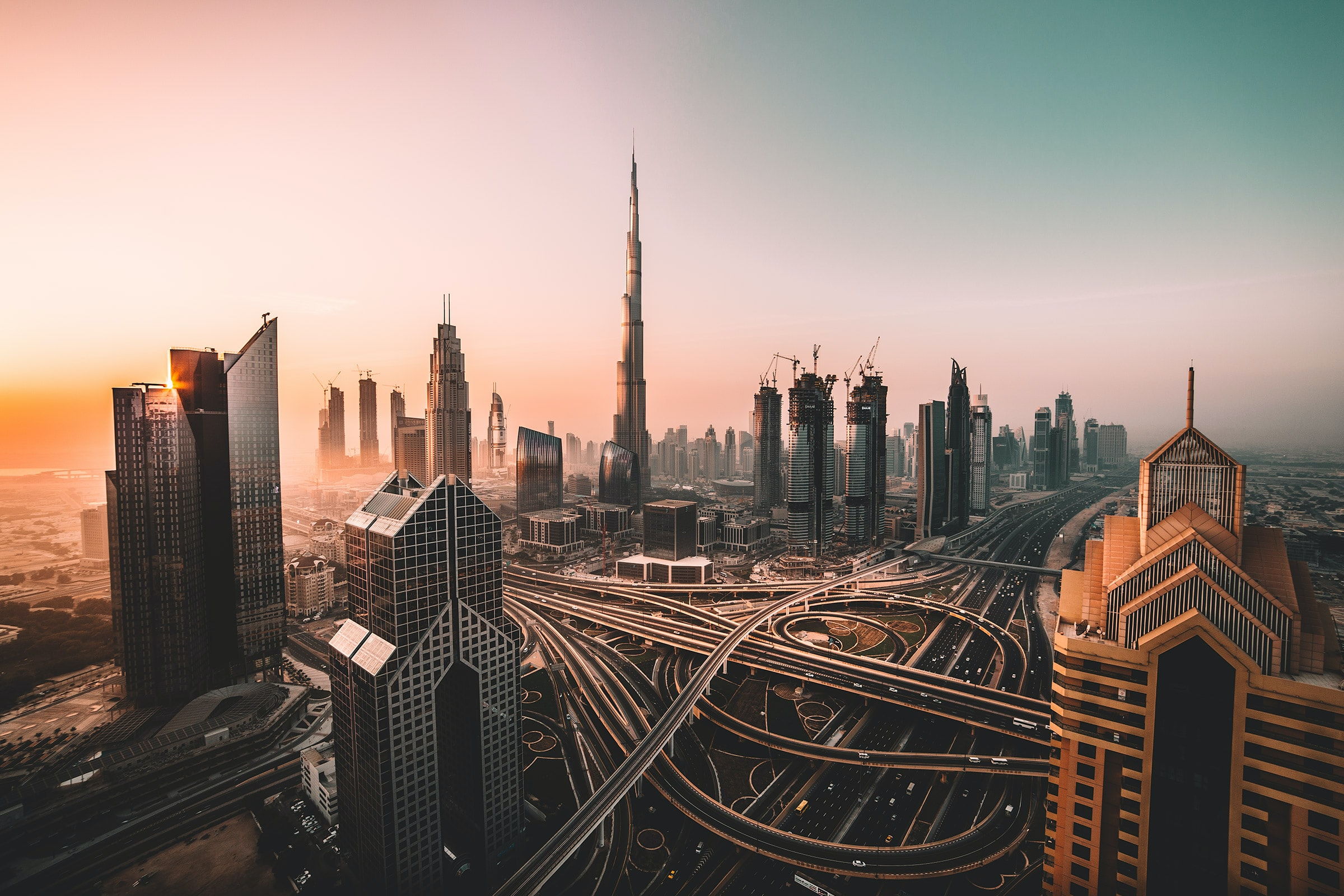 Sunrise shot of Downtown Dubai and Burj Khalifa; image by David Rodrigo, via Unsplash.com.