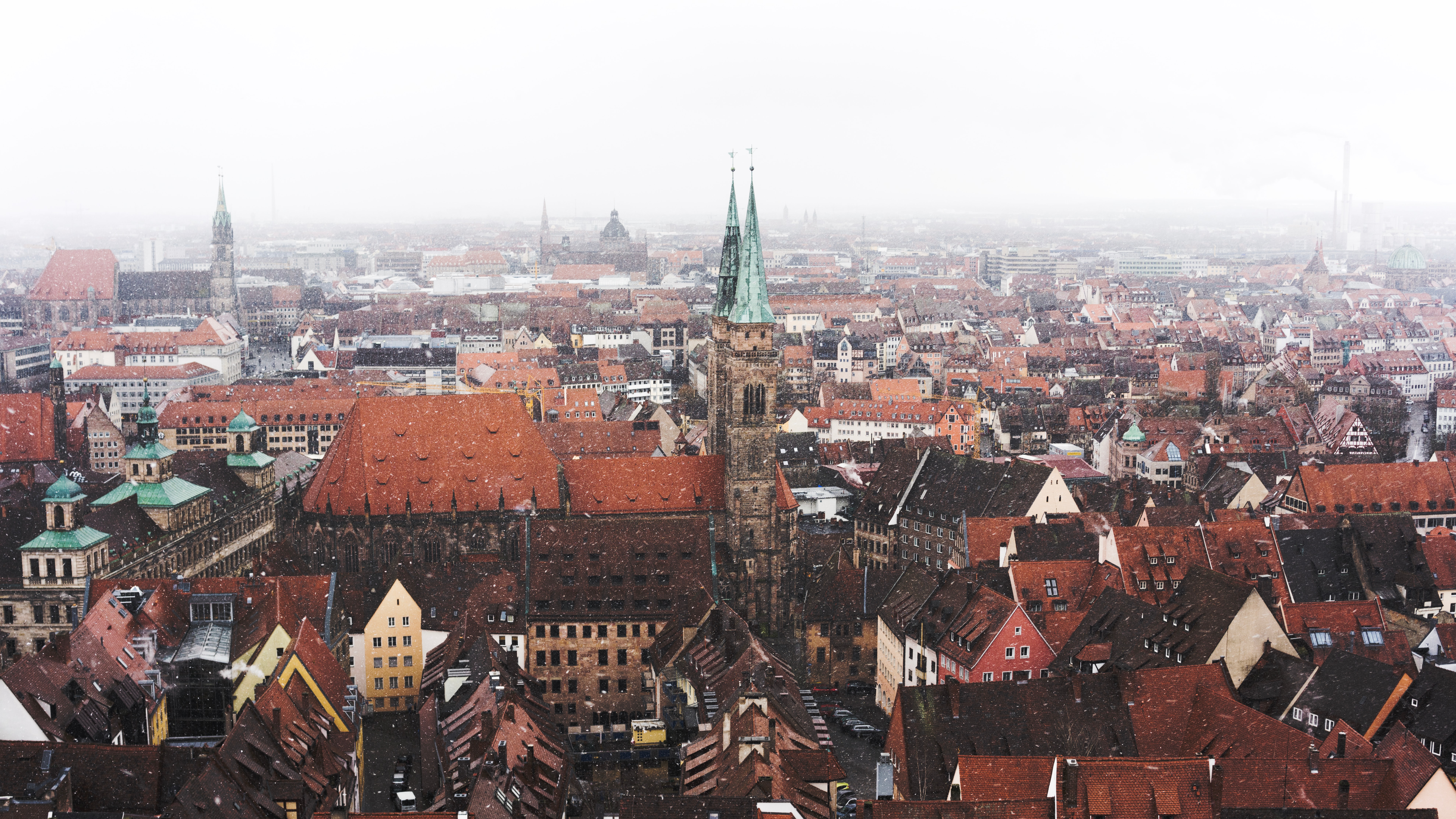 Snow falling on the city of Nuremberg, Germany; image by Kadir Celep, via Unsplash.com.