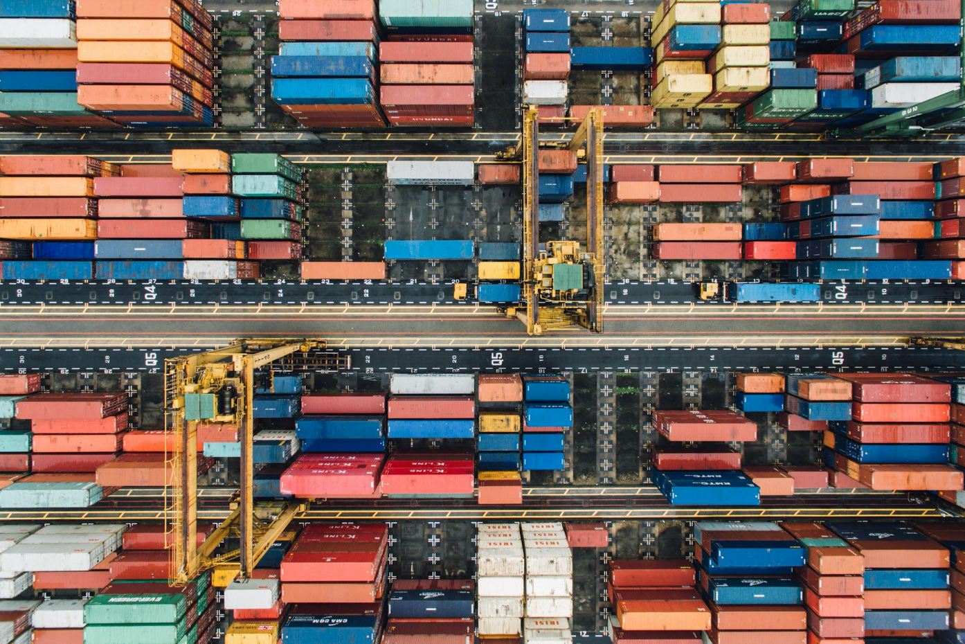 Aerial view of shipping containers; image by Chuttersnap, via Unsplash.com.