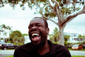 Man laughing; image by Brian Lundquist, via Unsplash.com.