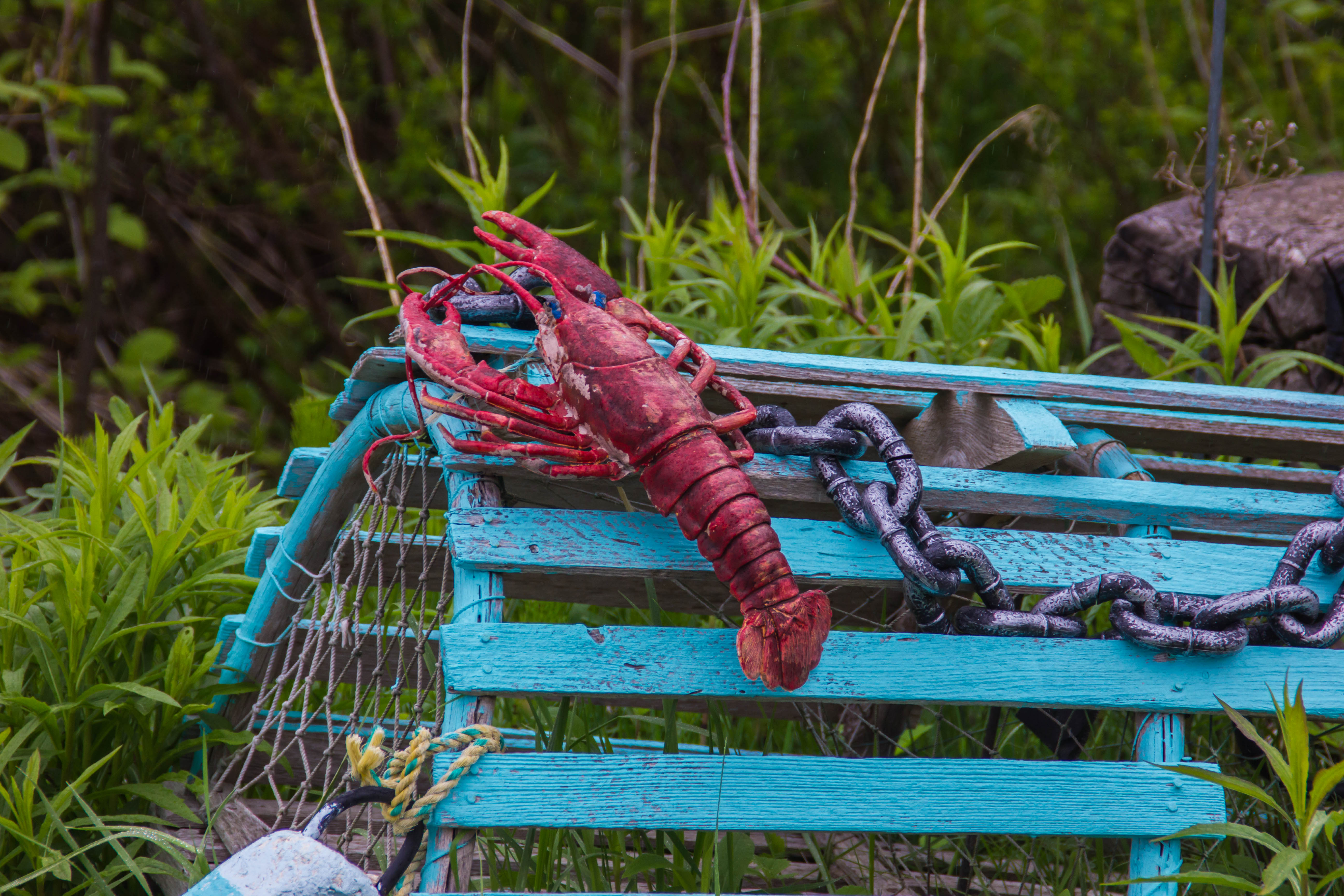 A blue, wooden lobster trap in Nova Scotia, Canada.