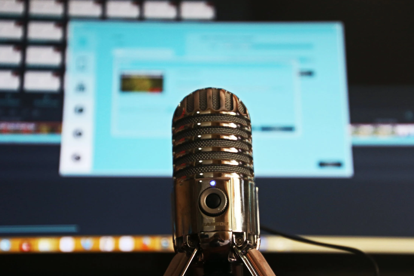 Selective focus shot of a microphone; image by Magda Ehlers, via Pexels.com.