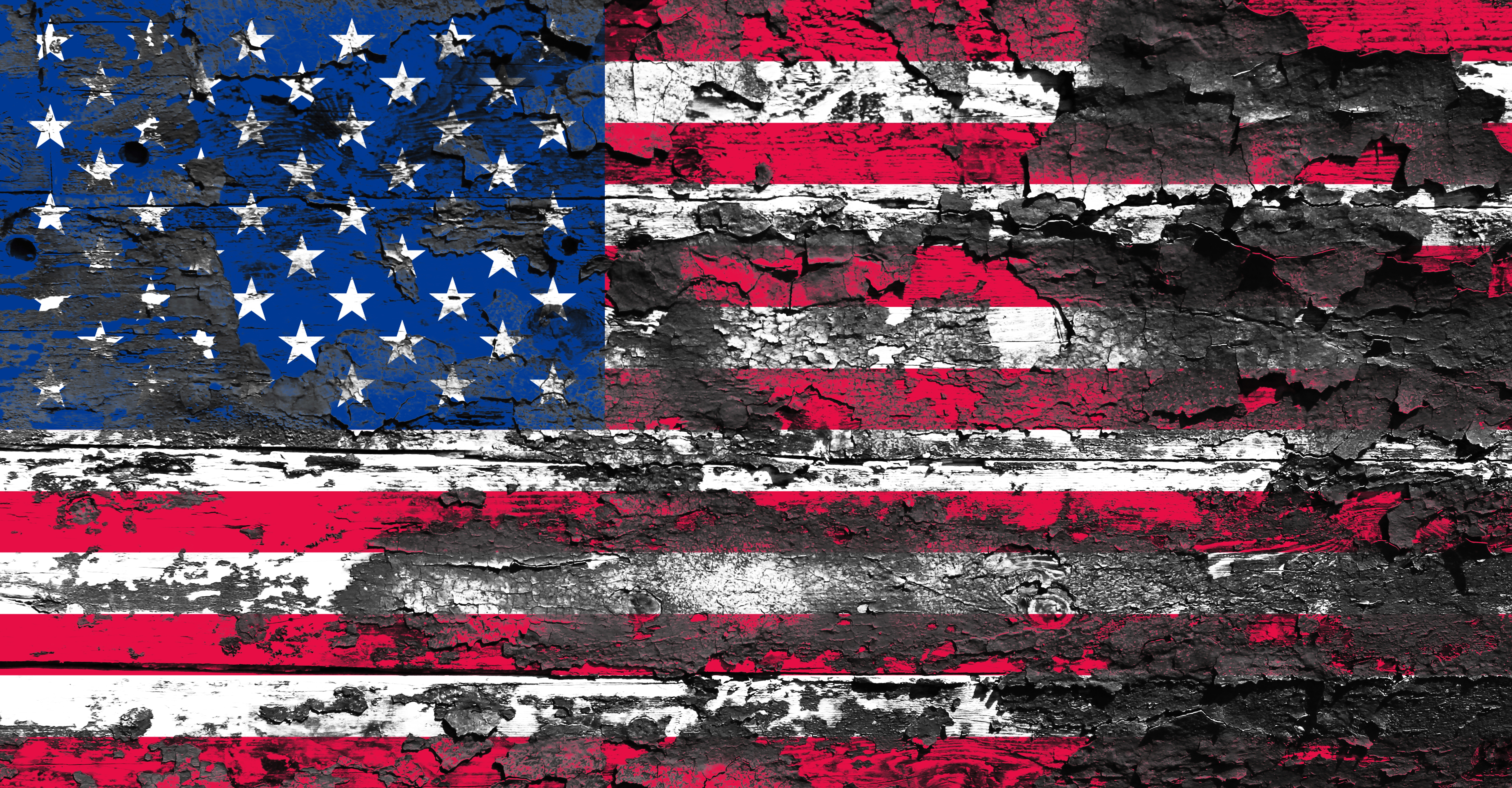 An American flag, pockmarked by peeling paint and decay.